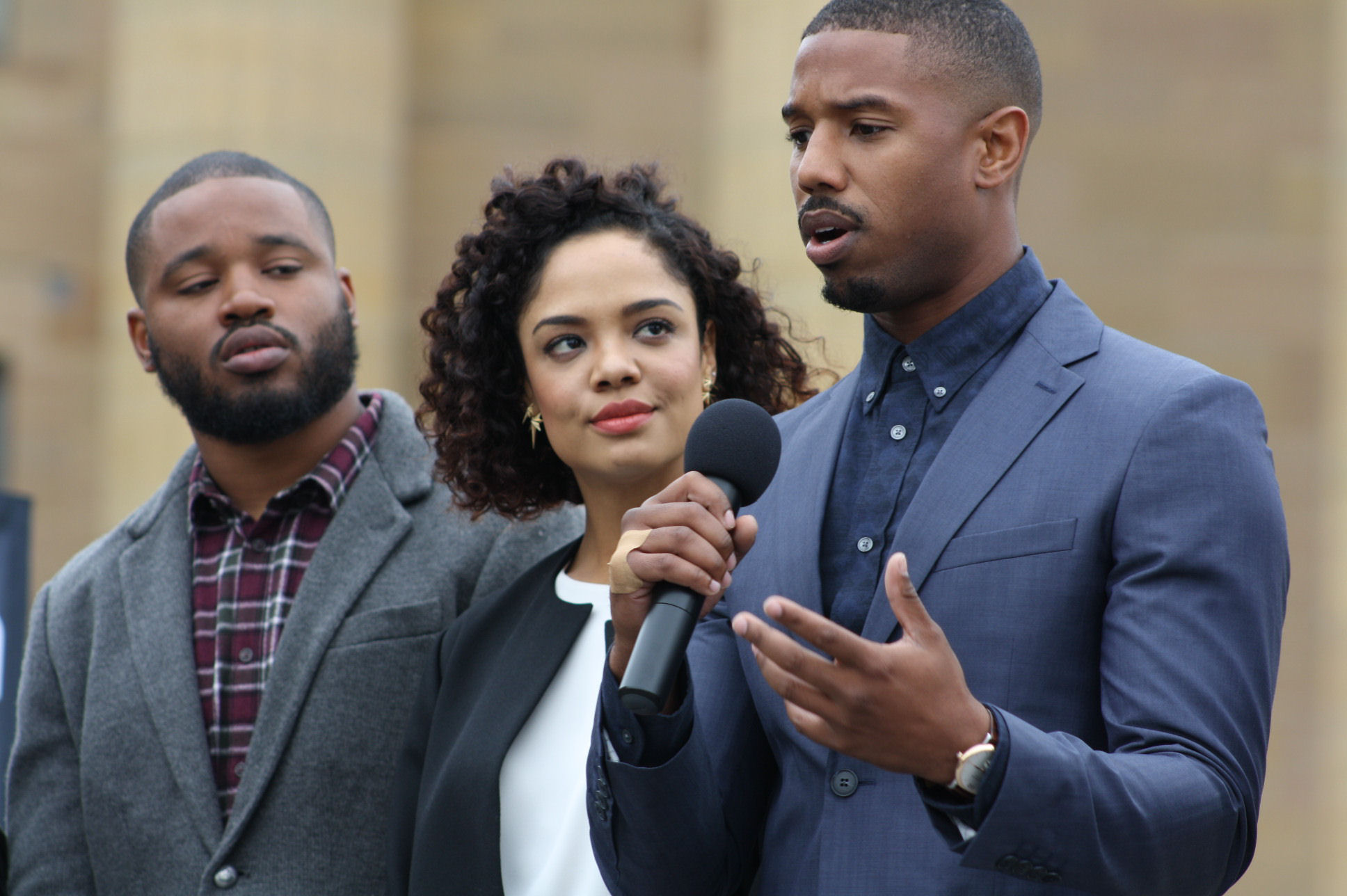 Director Ryan Coogler and co-star Tessa Thompson look on while Michael B Jordan talks about his role in the latest ROCKY franchise installment, CREED.