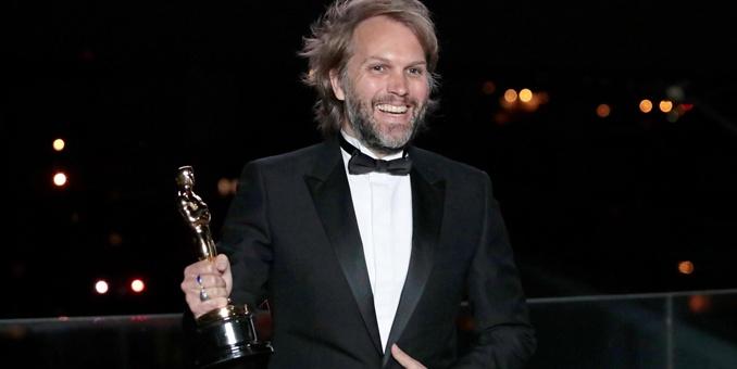 Florian Zeller holds his Oscar